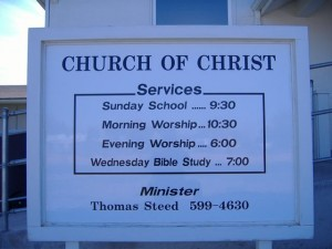 Church sign with services listed